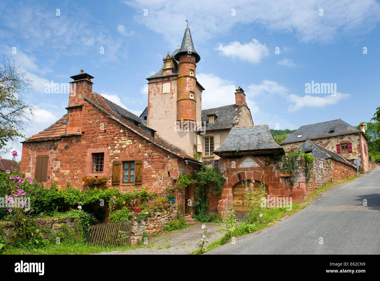 All the houses in the small picturesque city of Collonges la Rouge in France are built with red bricks - Stock Image