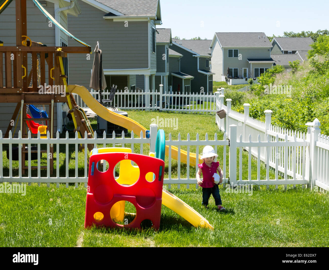 Small Child Plays in Backyard of  Army Officer Housing, United States Military Academy, West Point, NY, USA Stock Photo