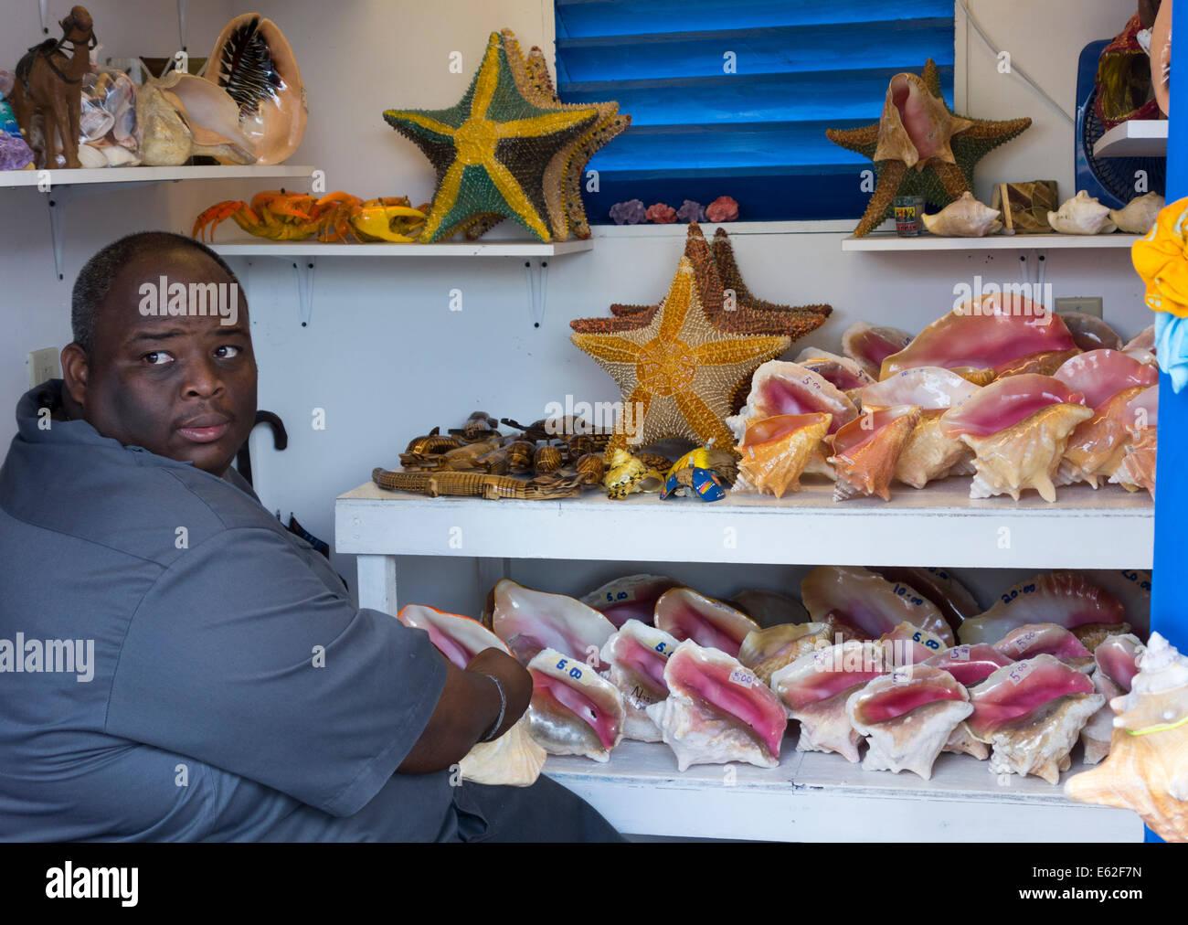 man selling shells to cruise passengers, Nassau, Providence Island, The Bahamas - Stock Image