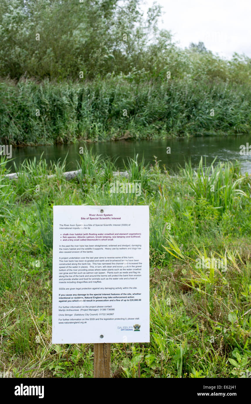 Small sign next to River Avon Salisbury UK indicating an SSSI site of special scientific interest - Stock Image