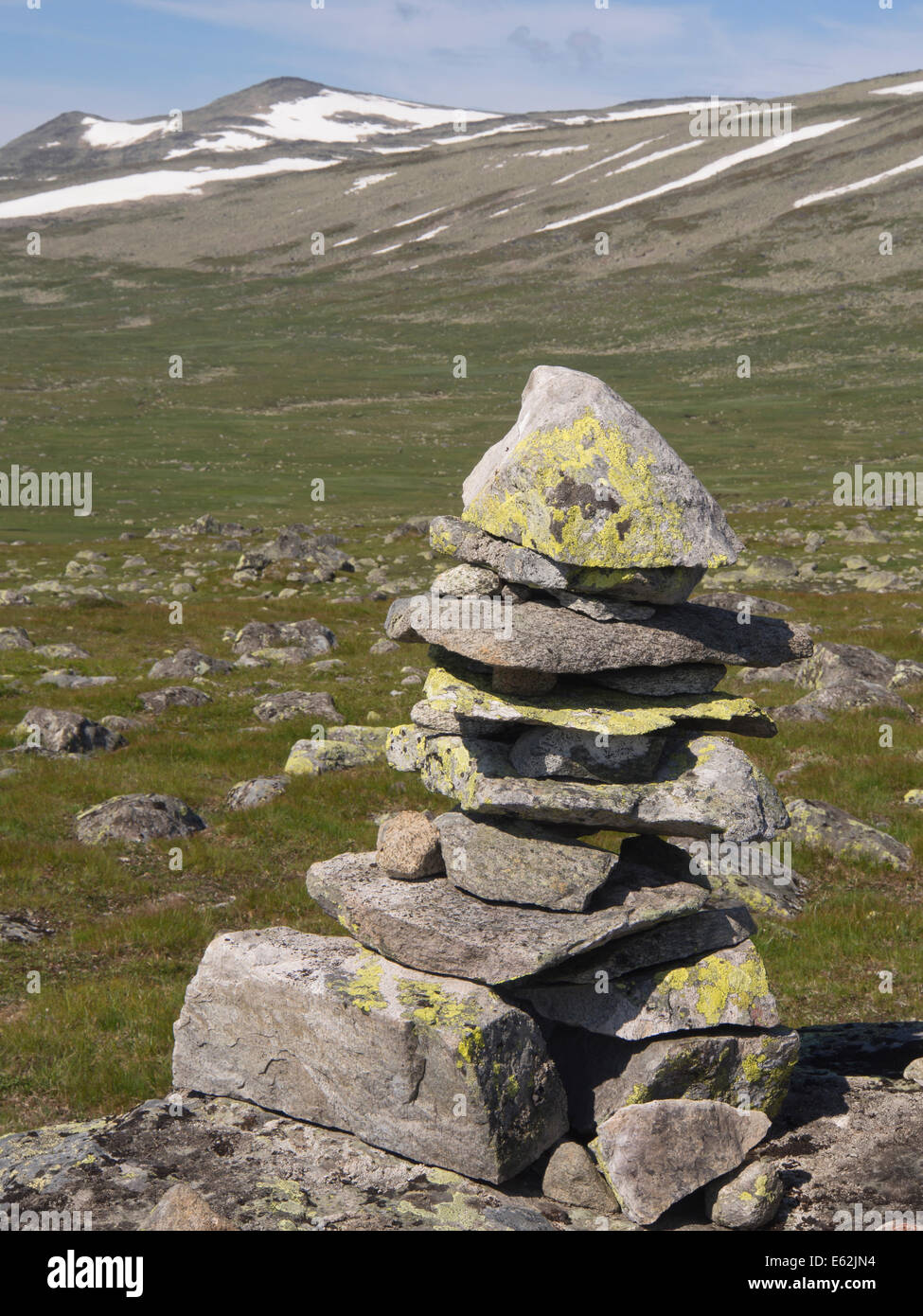 Valdresflya in Jotunheimen Norway, barren but inviting in the summer sun, small cairn leading the way into the mountains - Stock Image