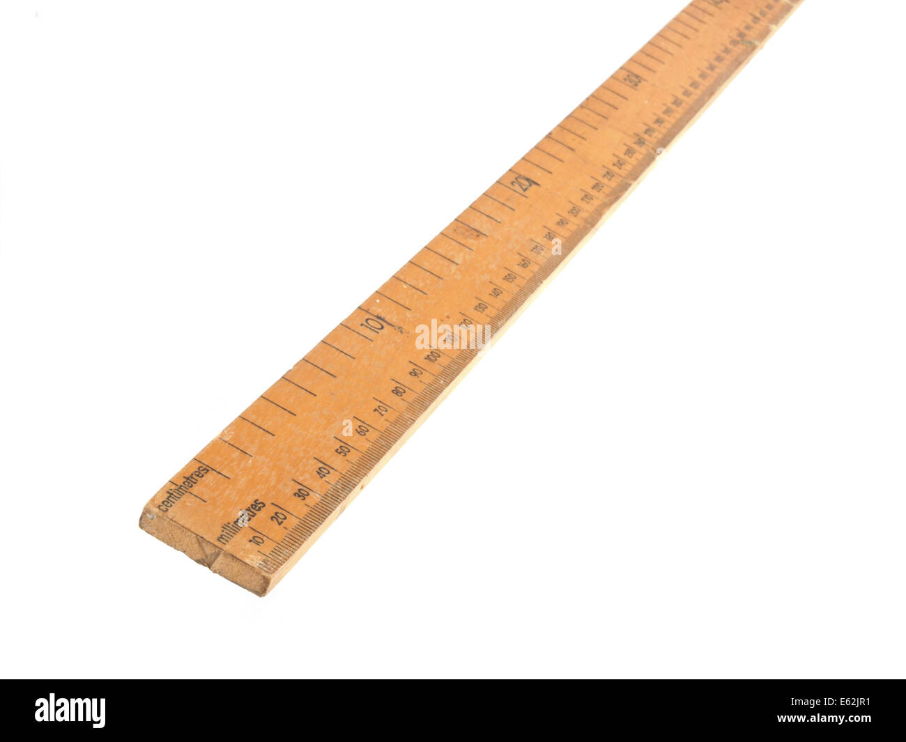 Close up photo of a wooden metric ruler on a white background - Stock Image