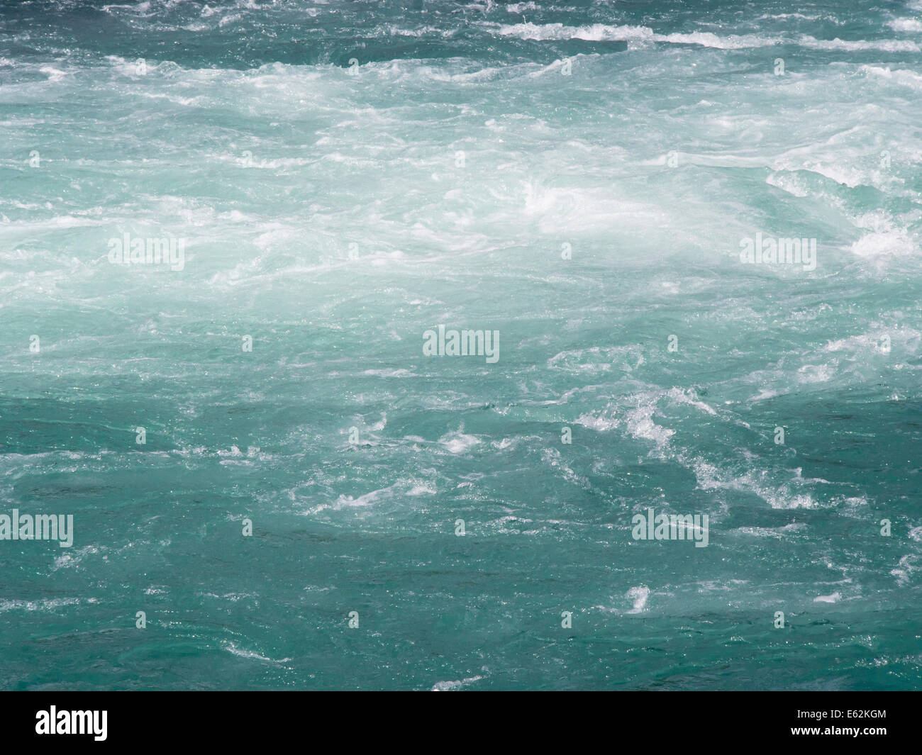 Close up of fresh, clean, rushing river water, ice blue coming from glacier in Norwegian mountains - Stock Image