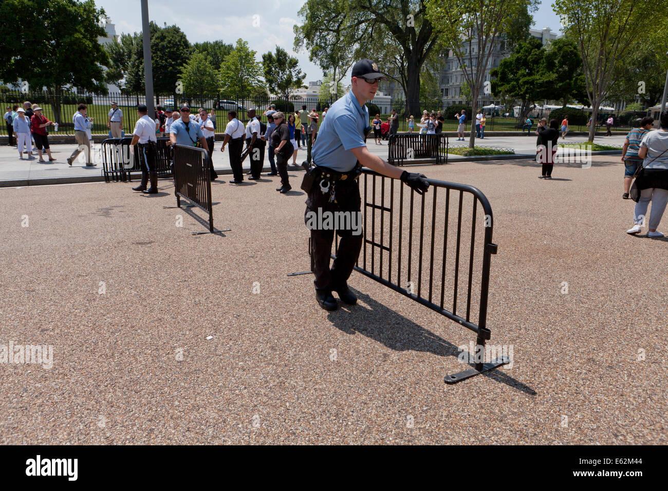 Police moving barricade fences - Washington, DC USA - Stock Image