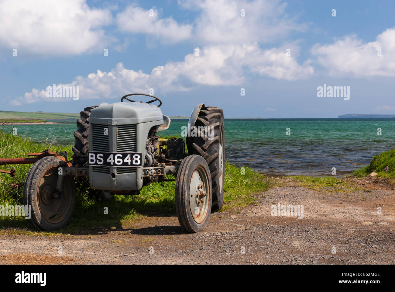 A Ferguson TO30 tractor by the sea in Orkney Scotland - Stock Image