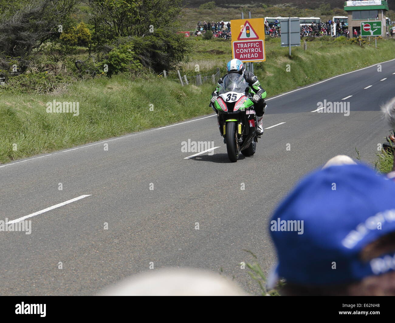 Karl Harris riding his Kawasaki, competing in the first Superbike race of the Isle of Man TT 2014. Stock Photo