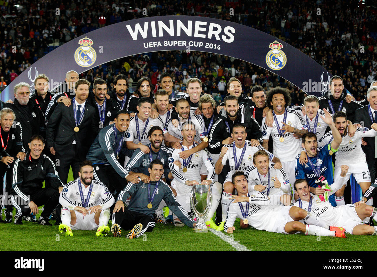 Cardiff, Wales. 12th Aug, 2014. UEFA Super Cup. Real Madrid CF v Sevilla FC. Real Madrid CF squad celebrate their - Stock Image