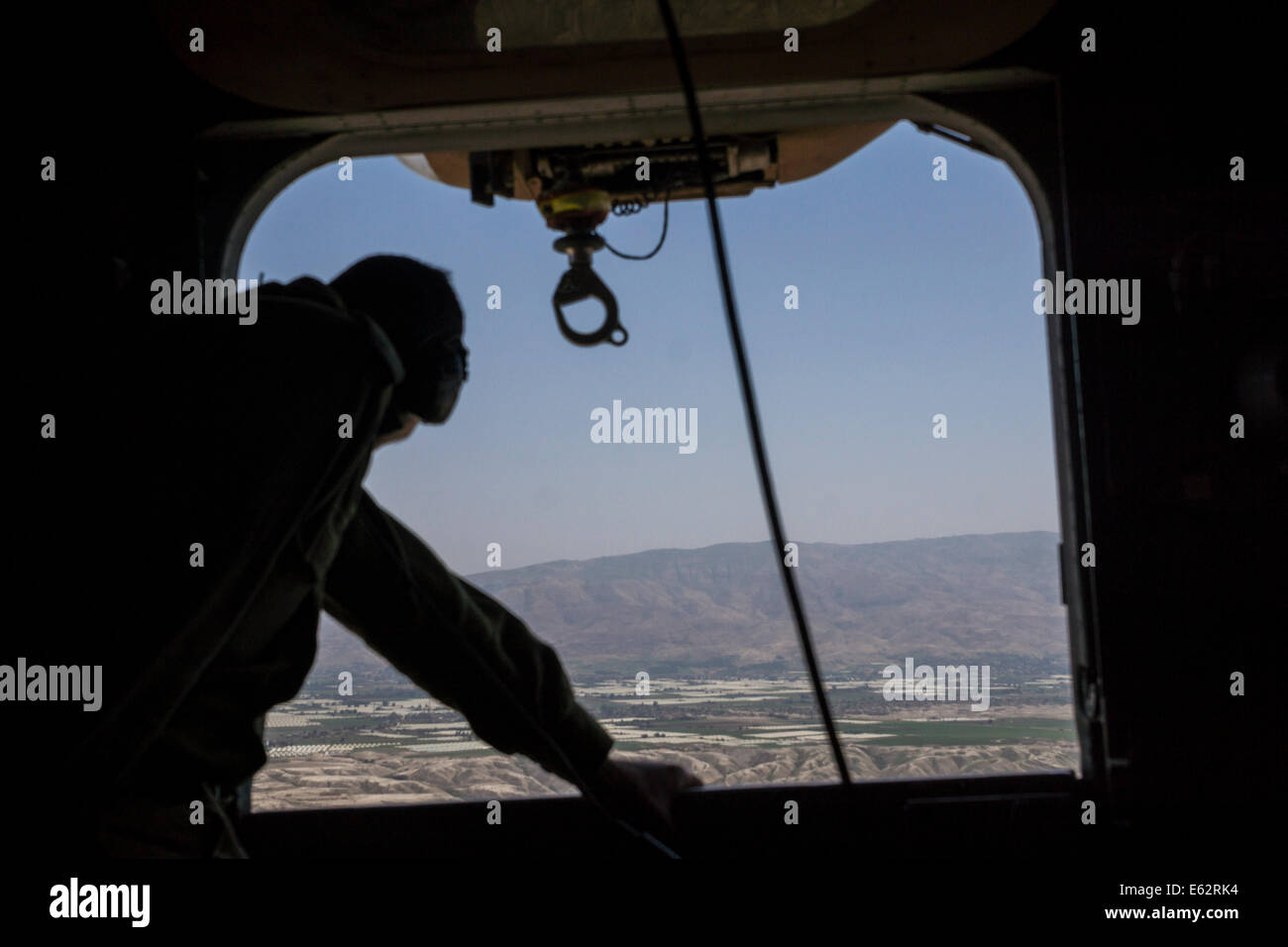 Israel. An army officer looks out of the window of an Helicopter, flying over jordan valley near the Israeli-Jordanian - Stock Image
