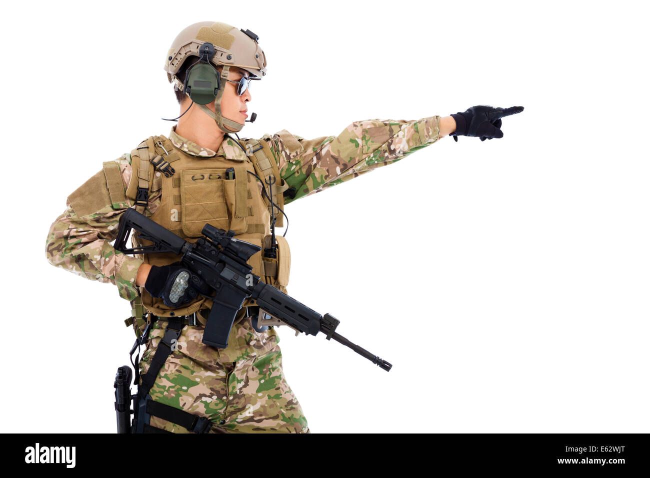 Soldier holding rifle or sniper and directing - Stock Image