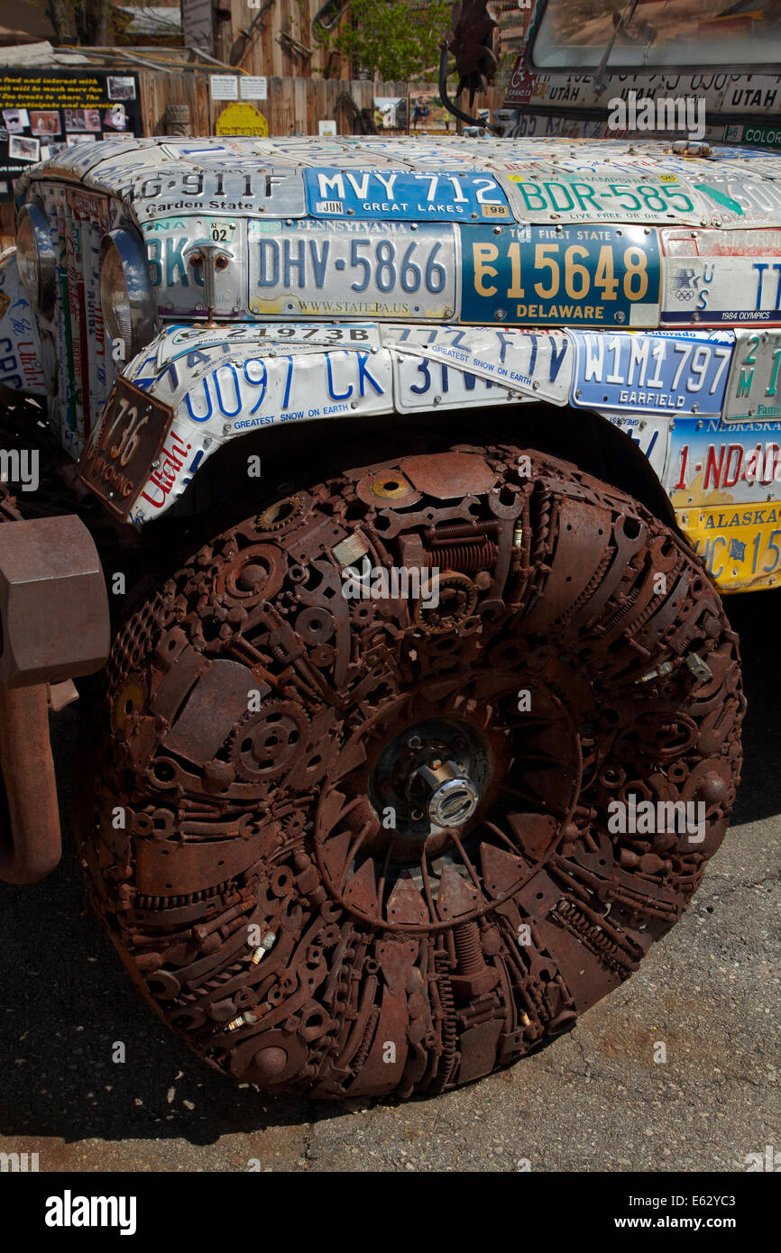 Jeep artwork made of numberplates and metal parts, Hole n the Rock tourist centre, near Moab, Utah, USA - Stock Image