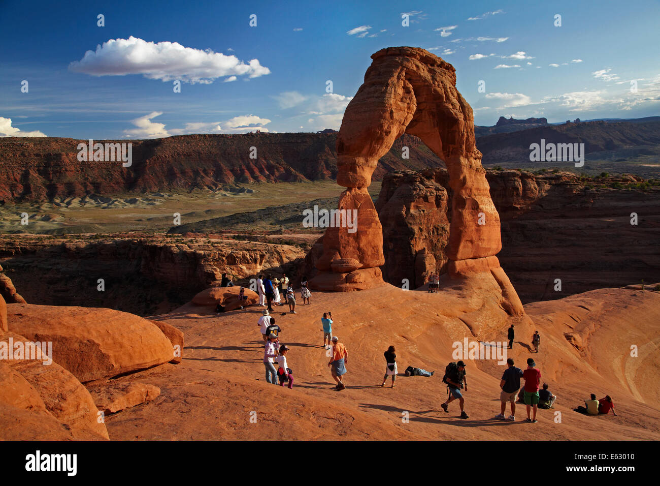 Delicate Arch (65 ft / 20 m tall iconic landmark of Utah), and tourists, Arches National Park, near Moab, Utah, - Stock Image