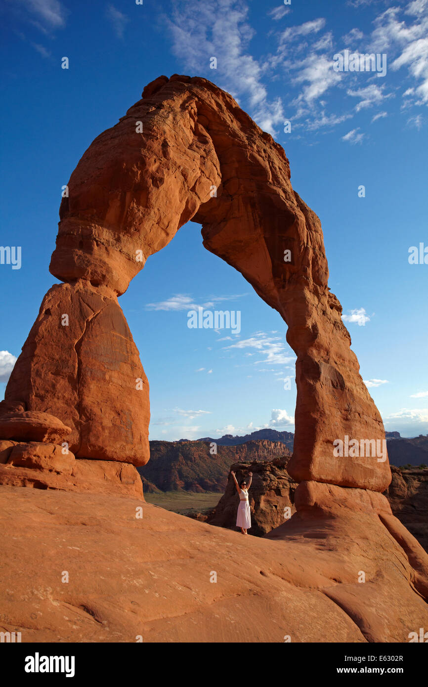Delicate Arch (65 ft / 20 m tall iconic landmark of Utah), and tourist, Arches National Park, near Moab, Utah, USA - Stock Image