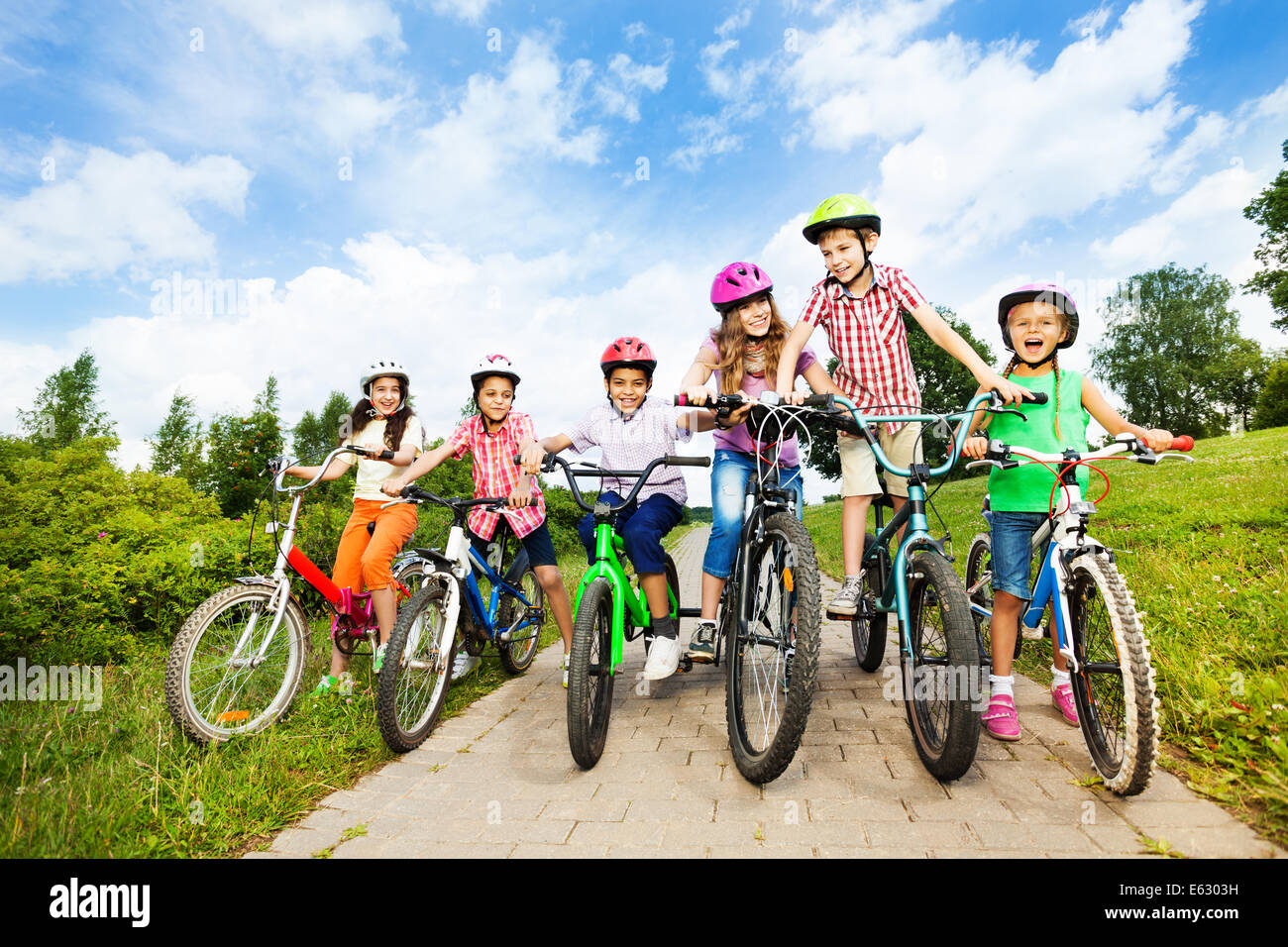 Happy kids in row wear colorful bike helmets Stock Photo  72595365 ... 61e544a13