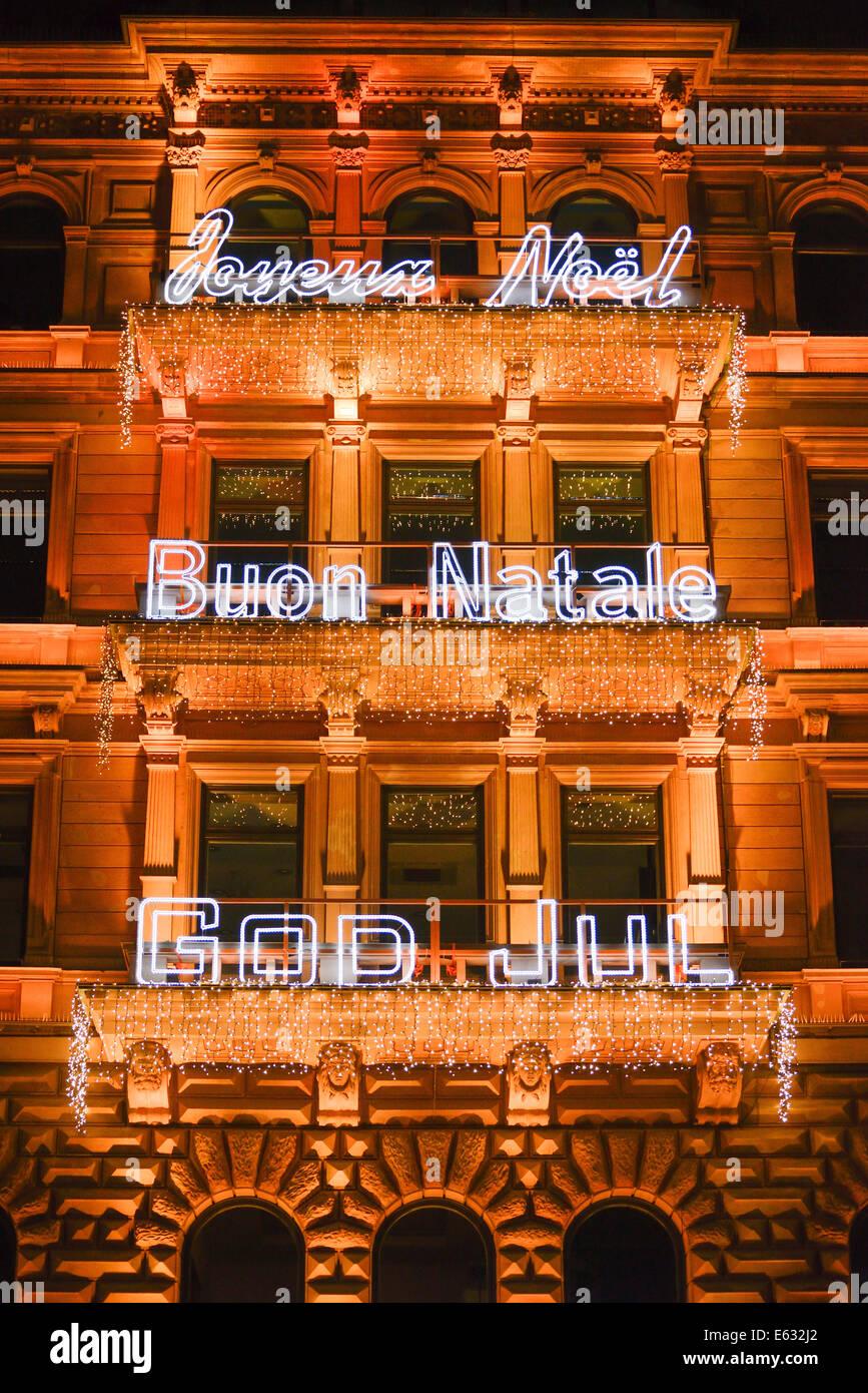 Christmas lights with writings in different languages, facade, Hamburger Hof, Jungfernstieg, Hamburg, Germany - Stock Image