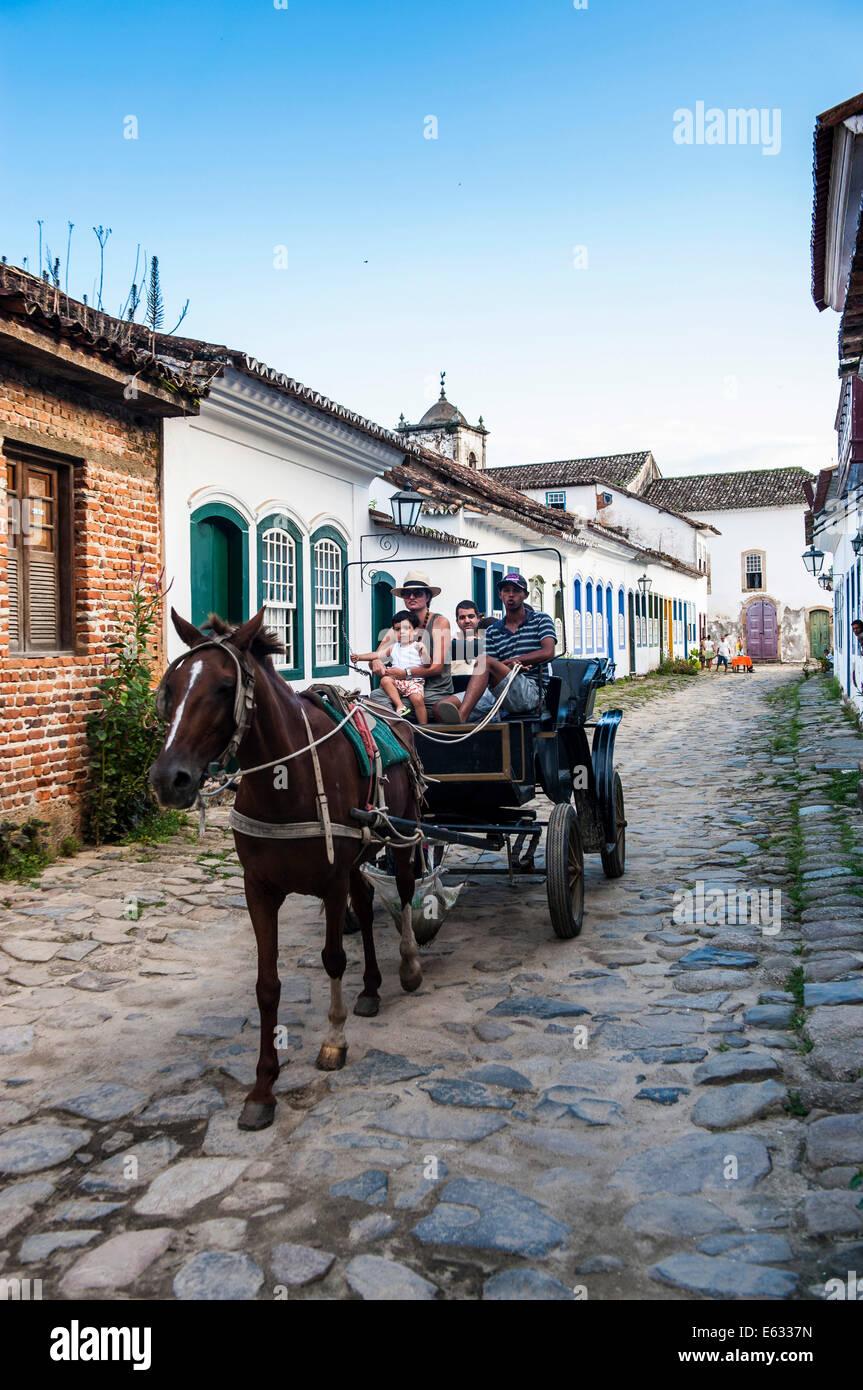 Horse cart with tourists, Paraty, Rio de Janeiro State, Brazil Stock Photo