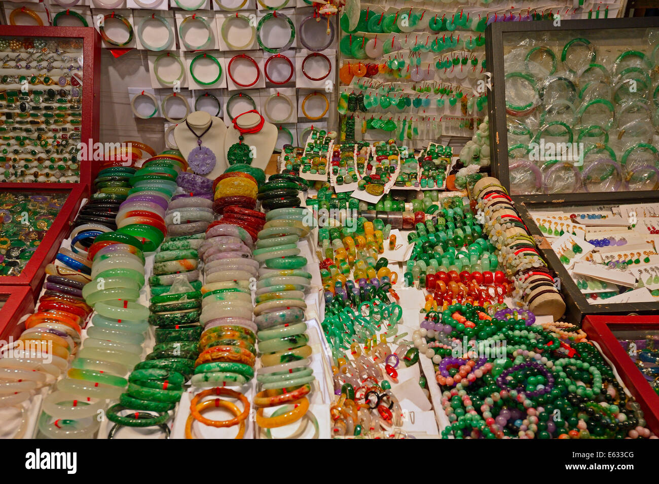 Various pieces of jewelry made of jade in the Jade Market, Kowloon, Hong Kong, China - Stock Image
