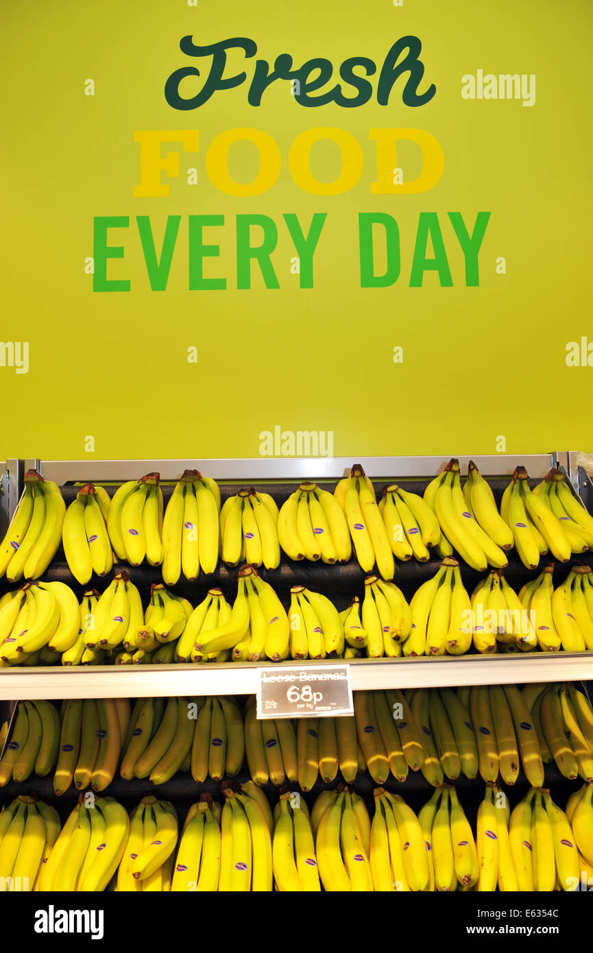 Bananas on a shelf in a supermarket . - Stock Image