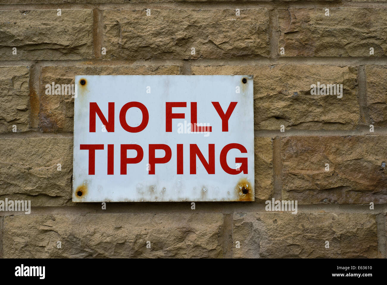 No Fly Tipping sign on wall - Stock Image