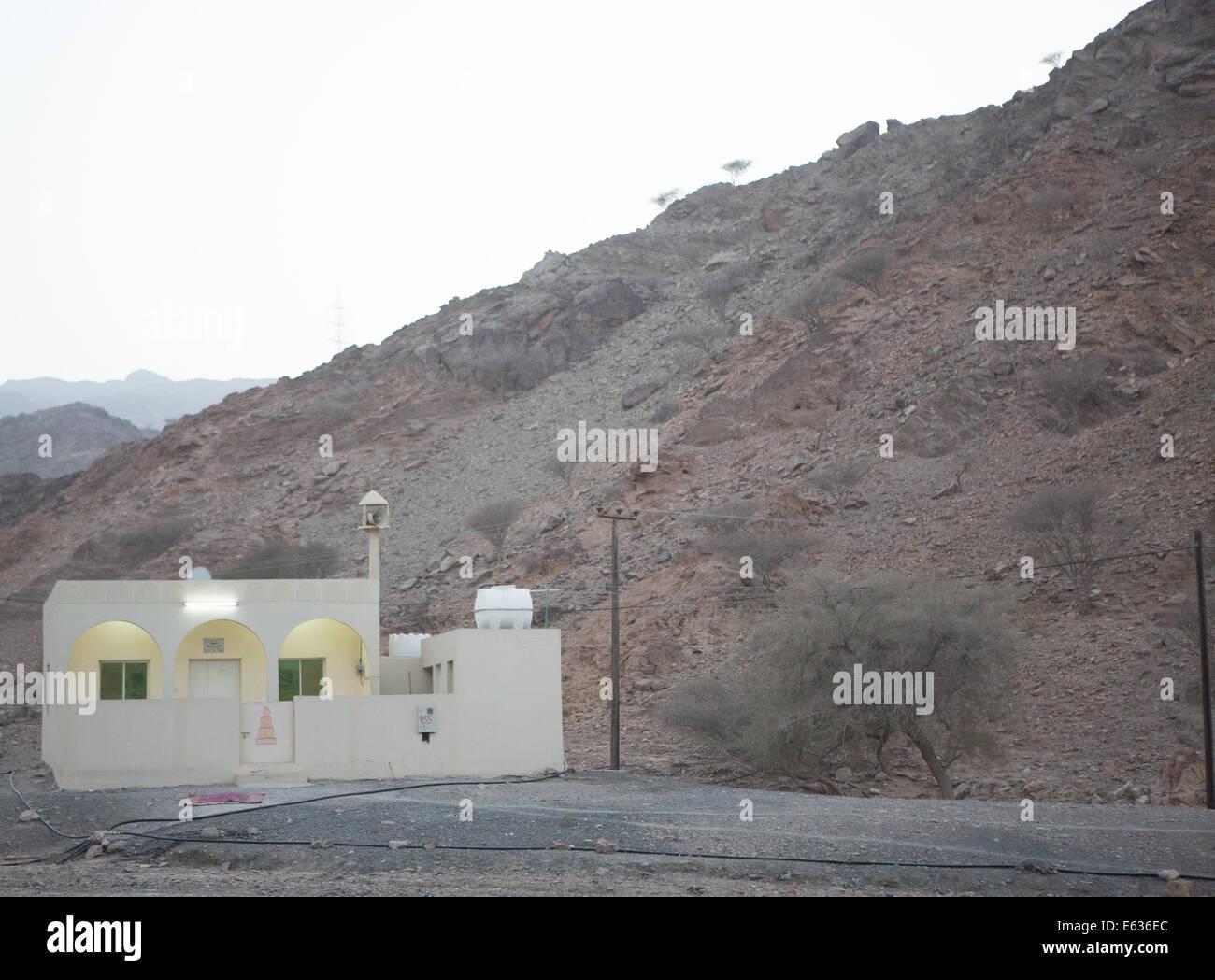 Road side mosque at dusk, Dibba, Fujairah, United Arab Emirates - Stock Image