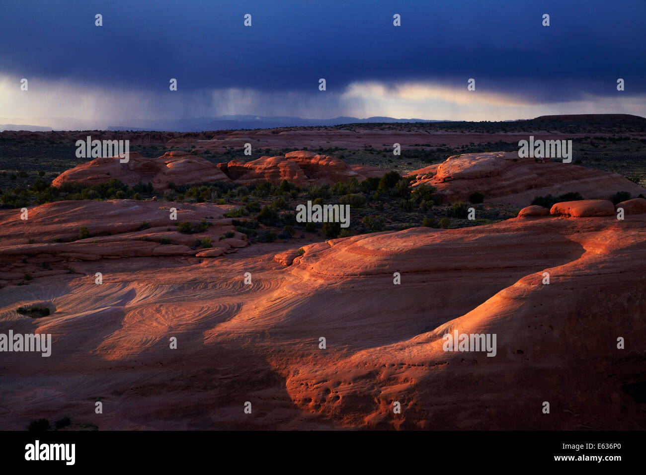 Eroded rock formations near Delicate Arch and approaching storm clouds, Arches National Park, near Moab, Utah, USA - Stock Image