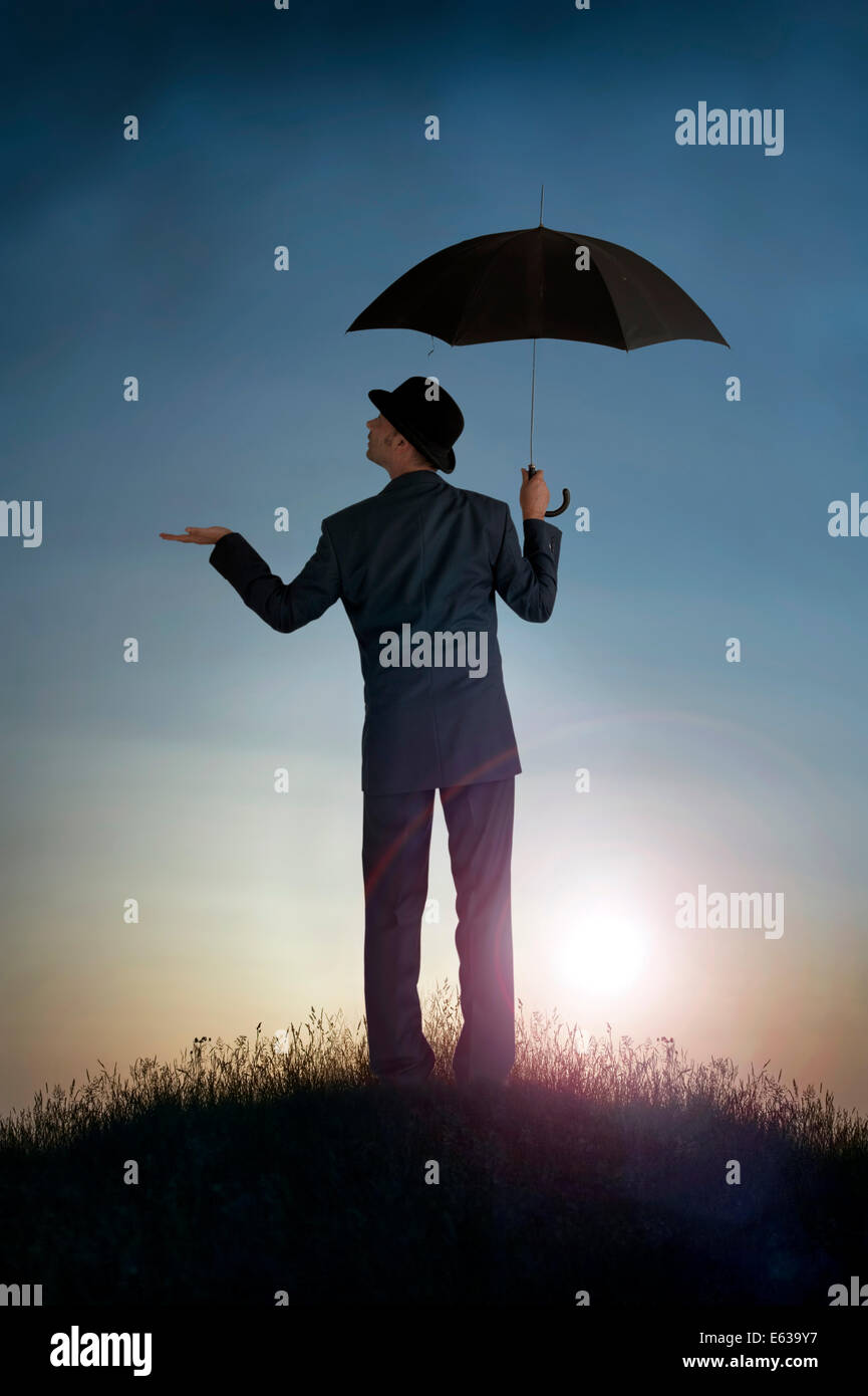 business forecast  bright outlook concept businessman feeling for rain - Stock Image