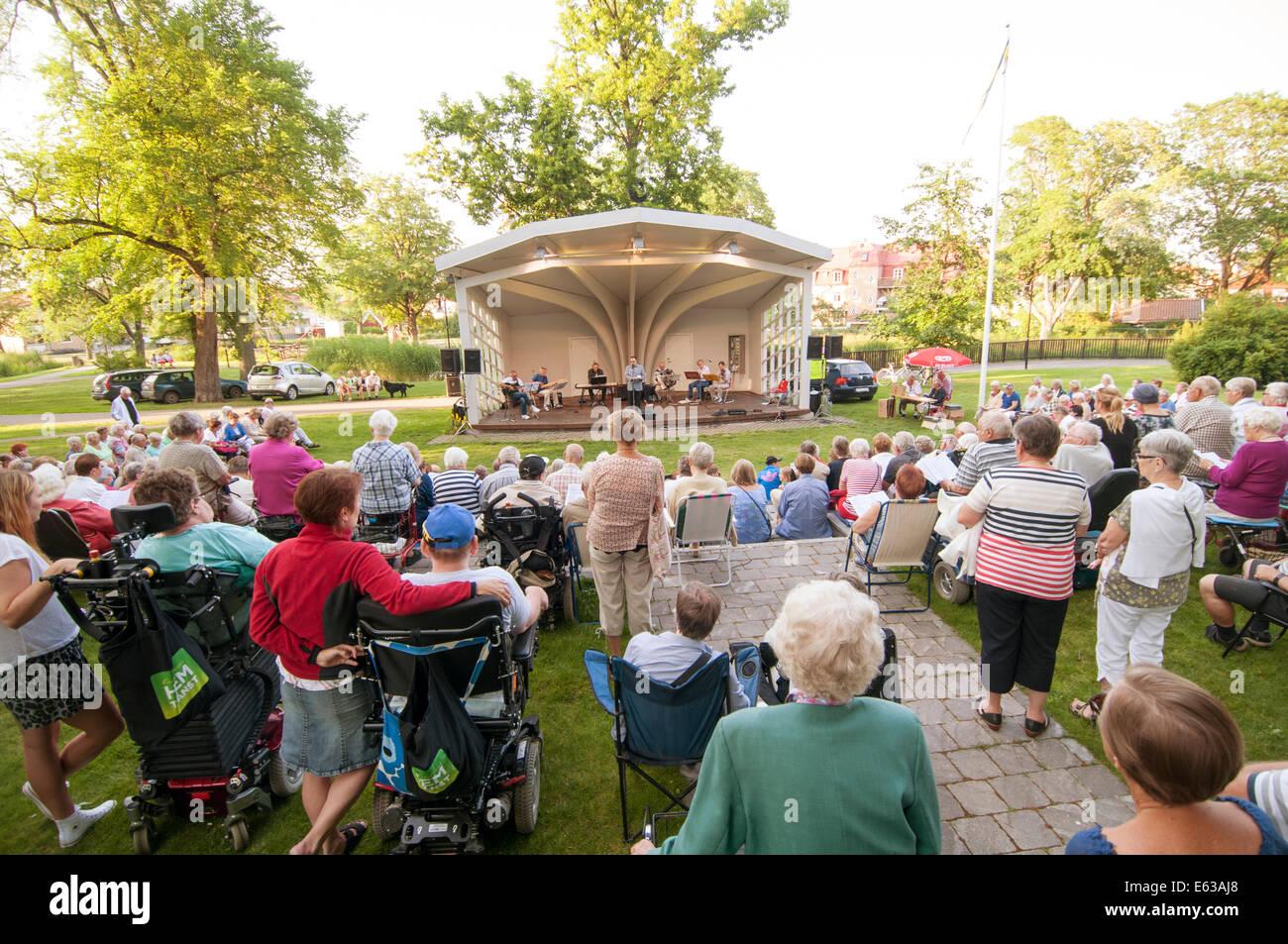 swedish folk music concert sweden old people at traditional festival in vastervik outdoor venuebandstand - Stock Image