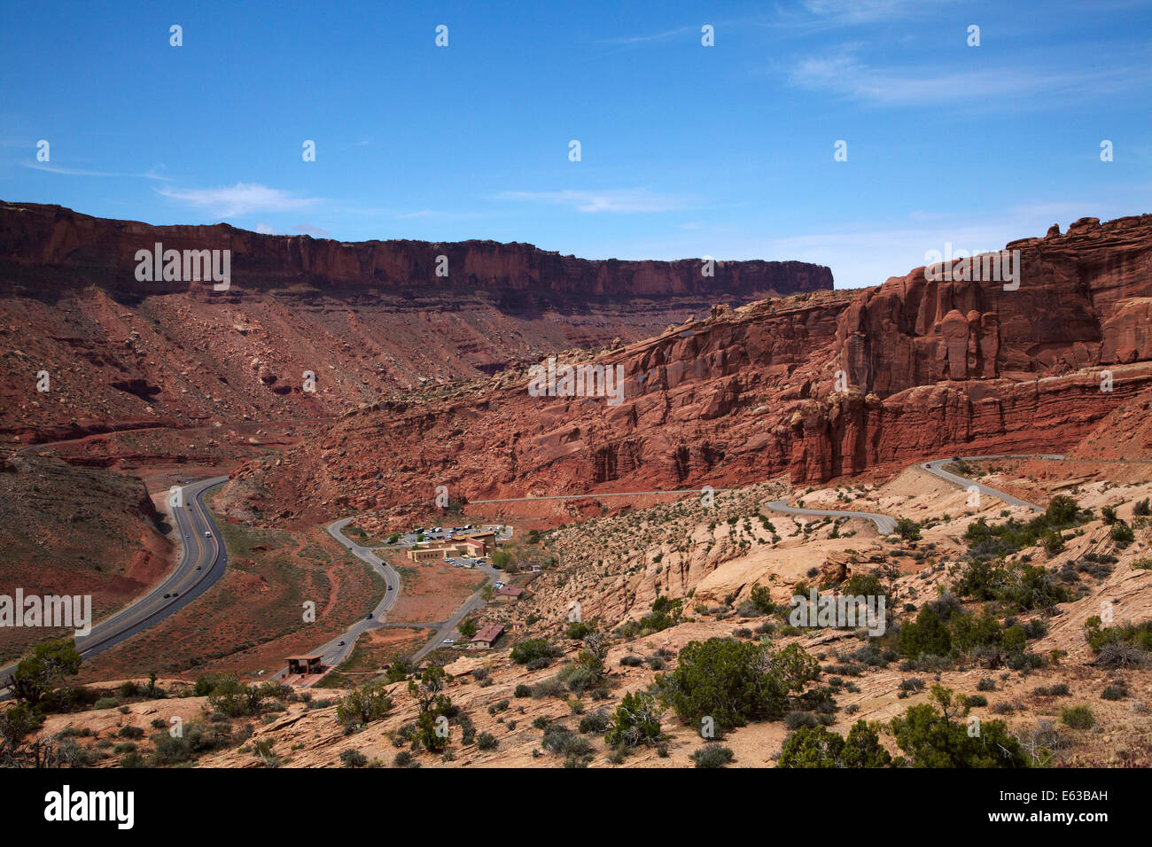 US route 191 and zigzag road entering Arches National Park, near Moab, Utah, USA - Stock Image