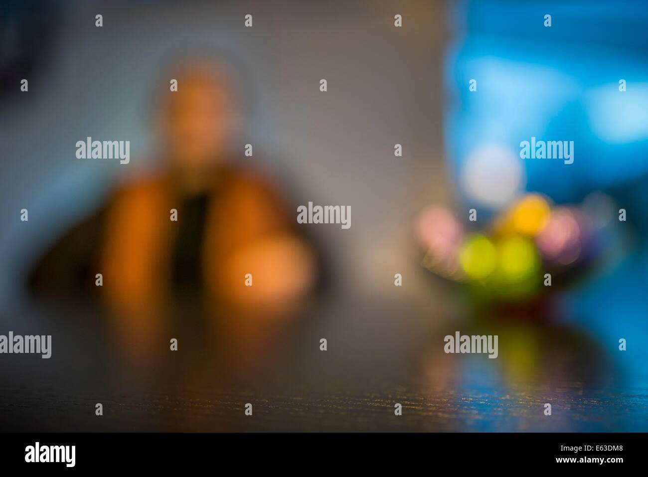 Portrait of woman with a fruit bowl, blurred effect. - Stock Image