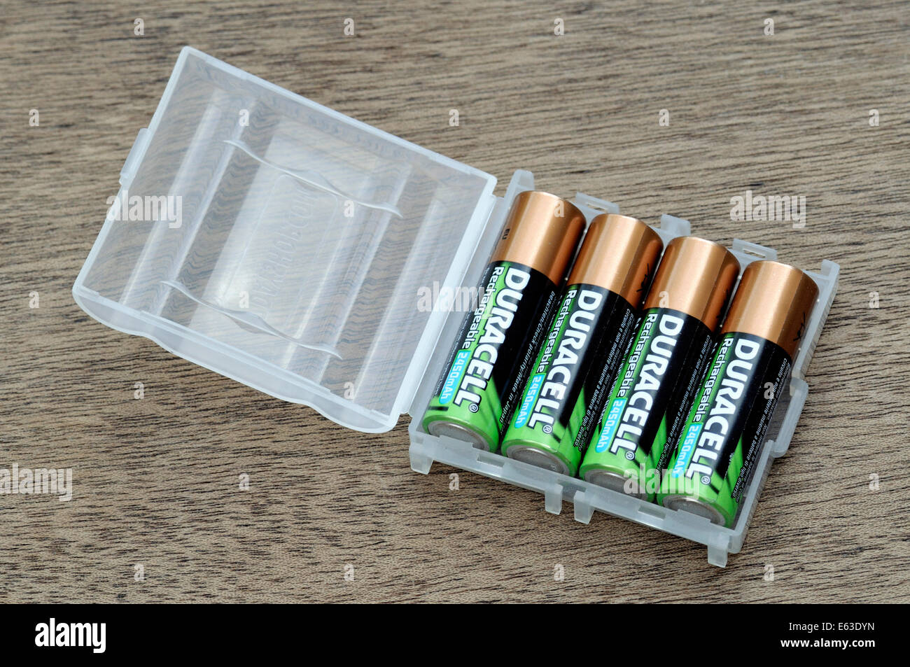 Four rechargeable batteries stored in plastic container. - Stock Image