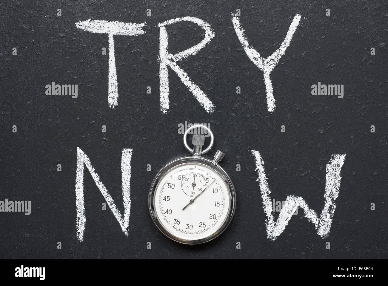 try now concept handwritten on chalkboard with vintage precise stopwatch used instead of O - Stock Image