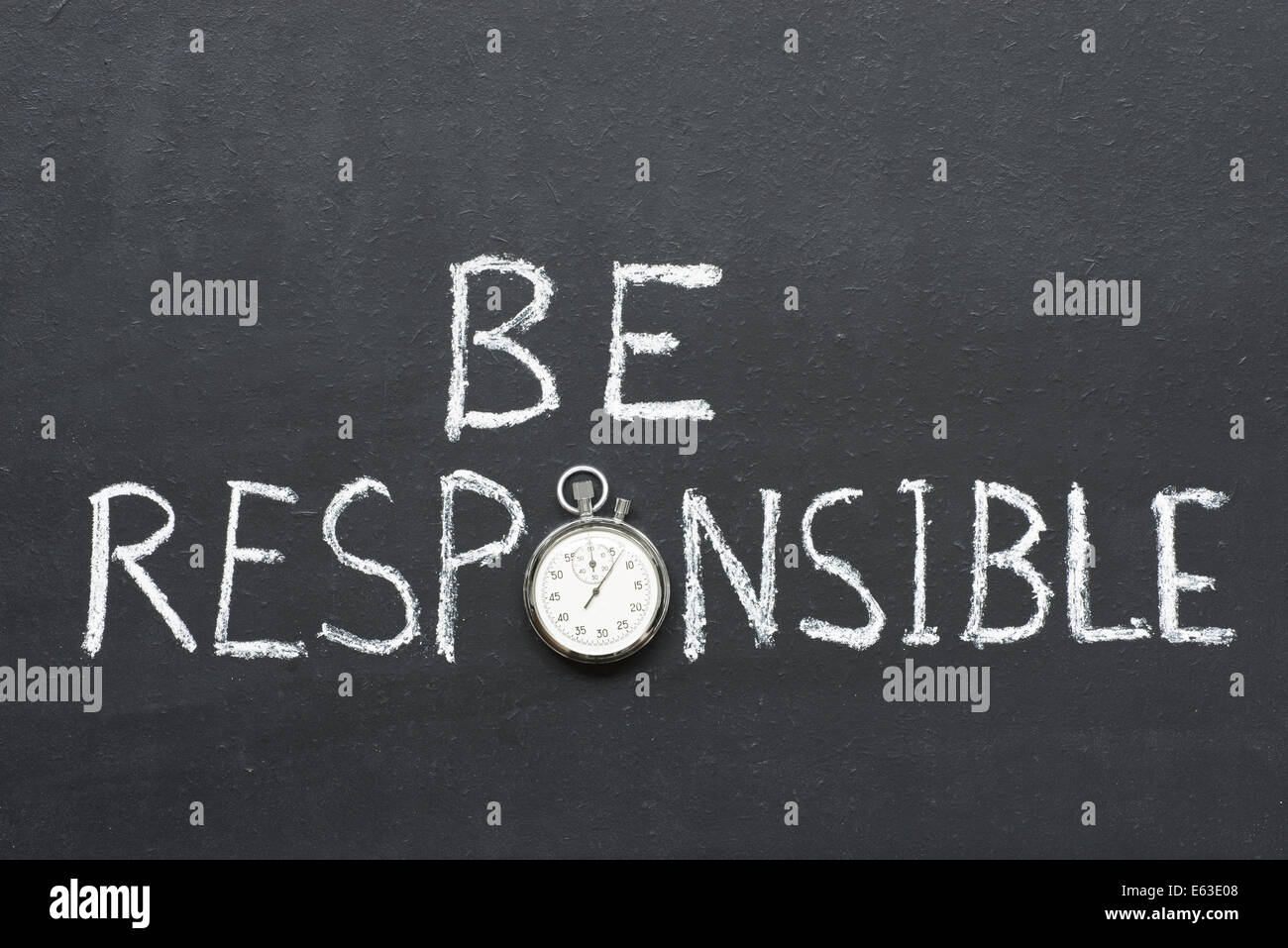 be responsible phrase handwritten on chalkboard with vintage precise stopwatch used instead of O - Stock Image