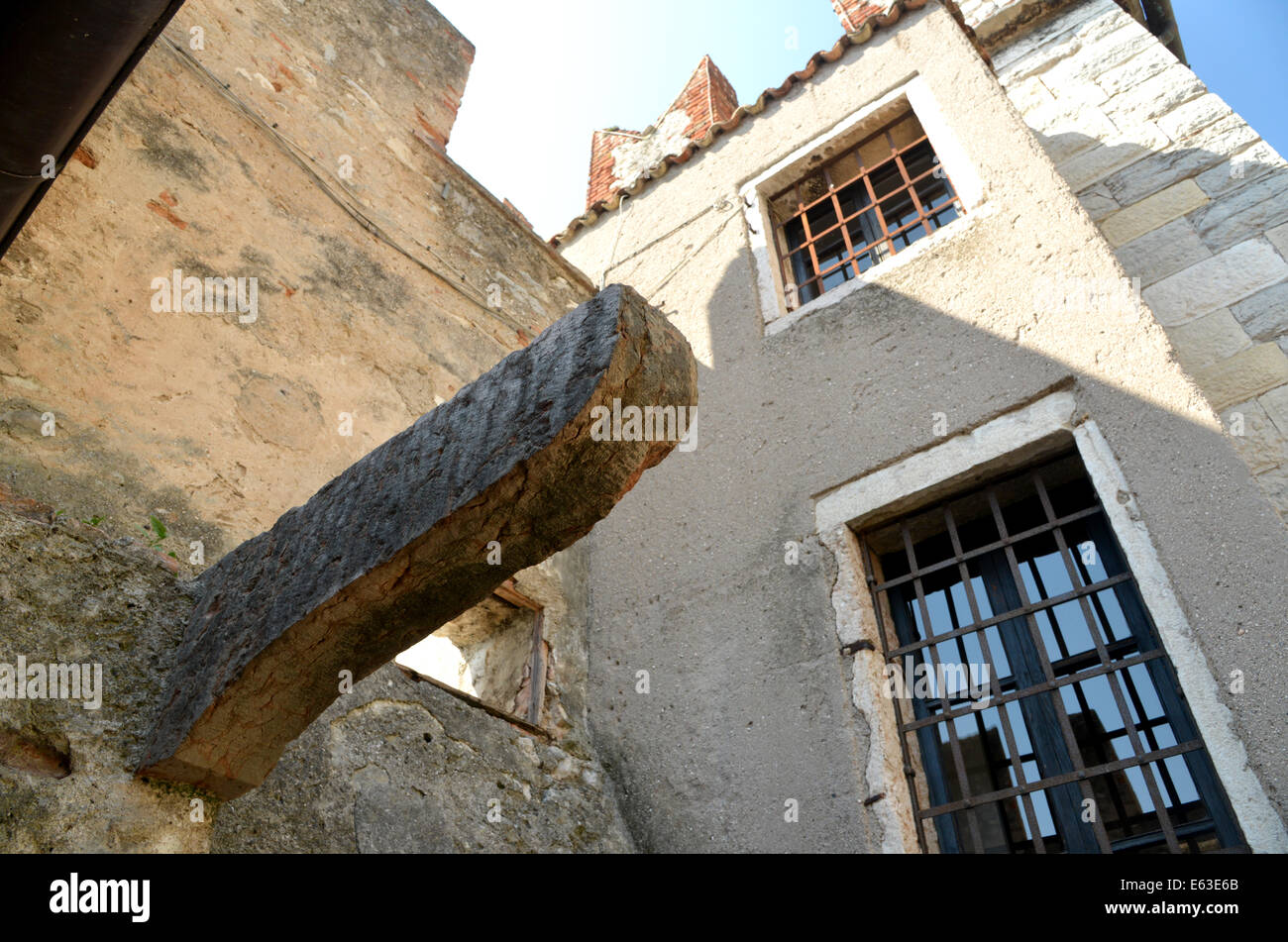 Old wooded joist protrudes from the wall in Malcesine Castle, Lake Garda, Italy - Stock Image