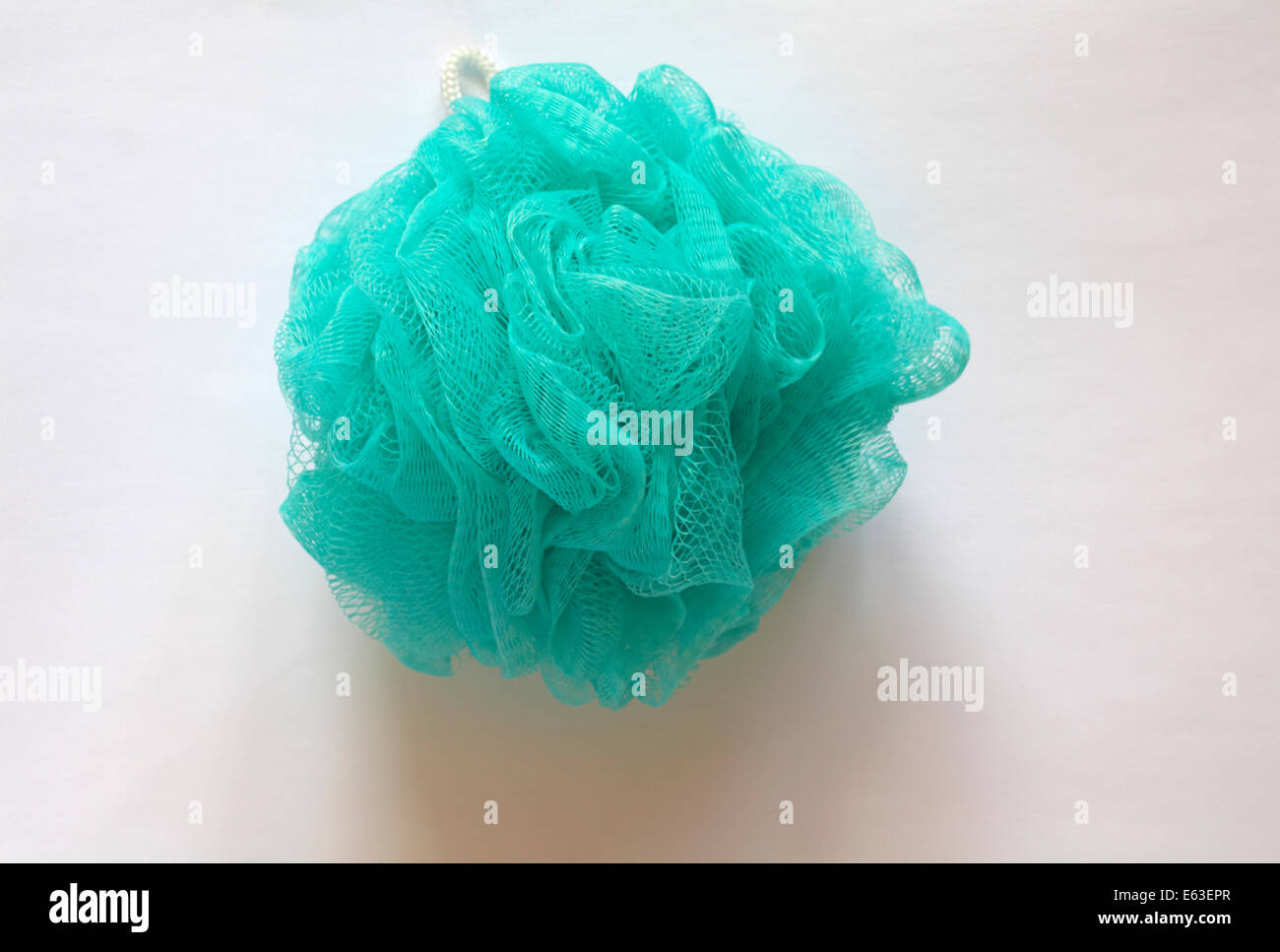 turquoise blue green body mop for bathing set on white background - Stock Image