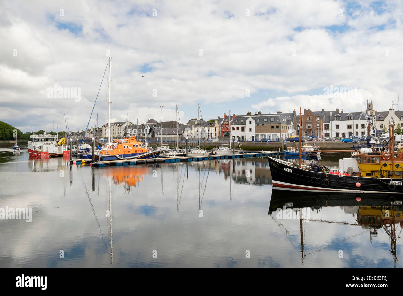 Moored boats reflected in calm water in the inner harbour. Stornoway, Isle of Lewis, Outer Hebrides, Western Isles, - Stock Image