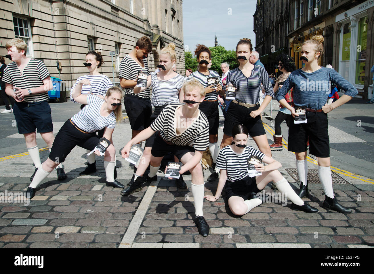 Scotland 2014. Edinburgh  Festival. The Fringe. Handing out flyers for 'The most serious ailments of St Kranks'. - Stock Image