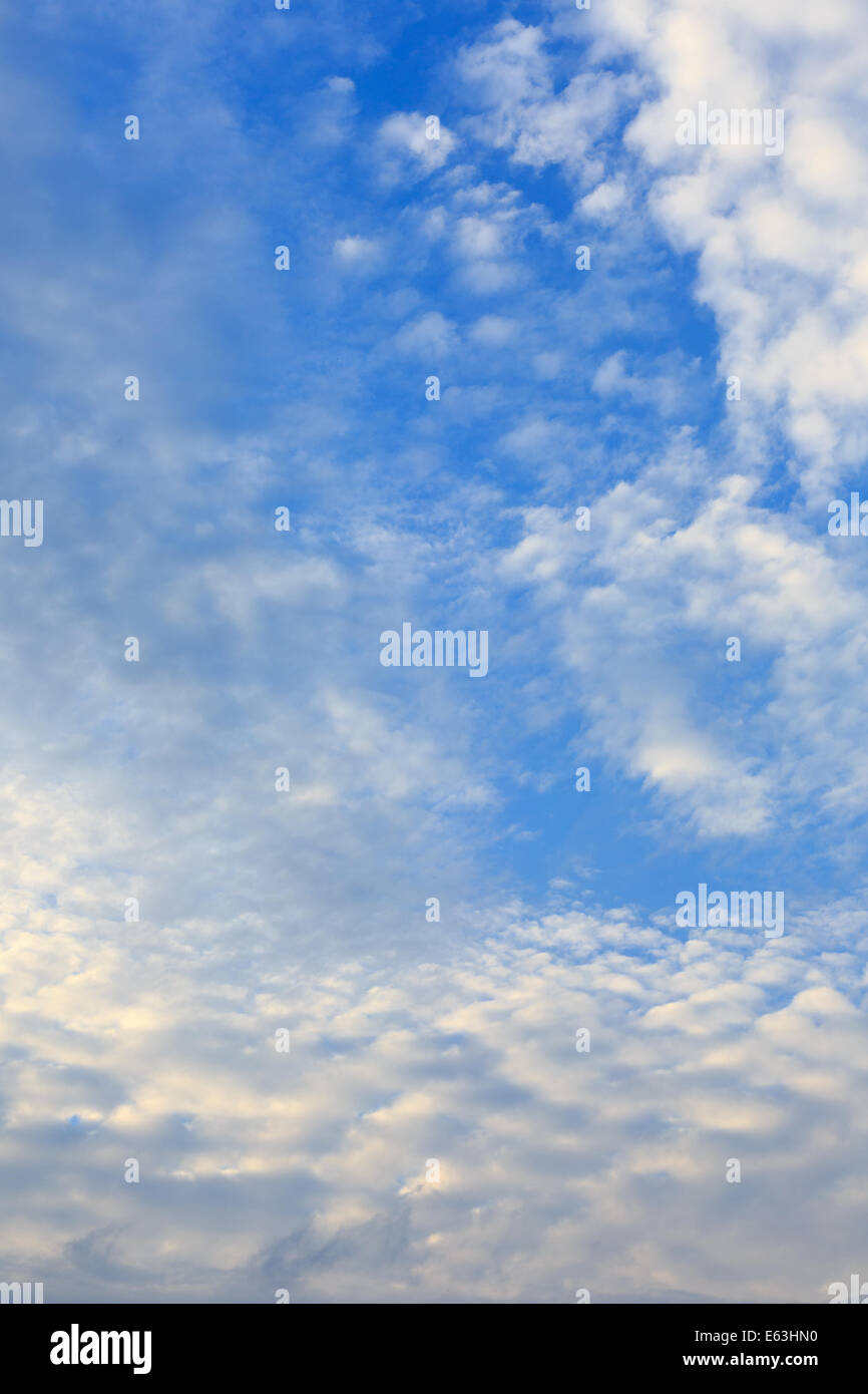 Autumn sky with fluffy clouds background Stock Photo