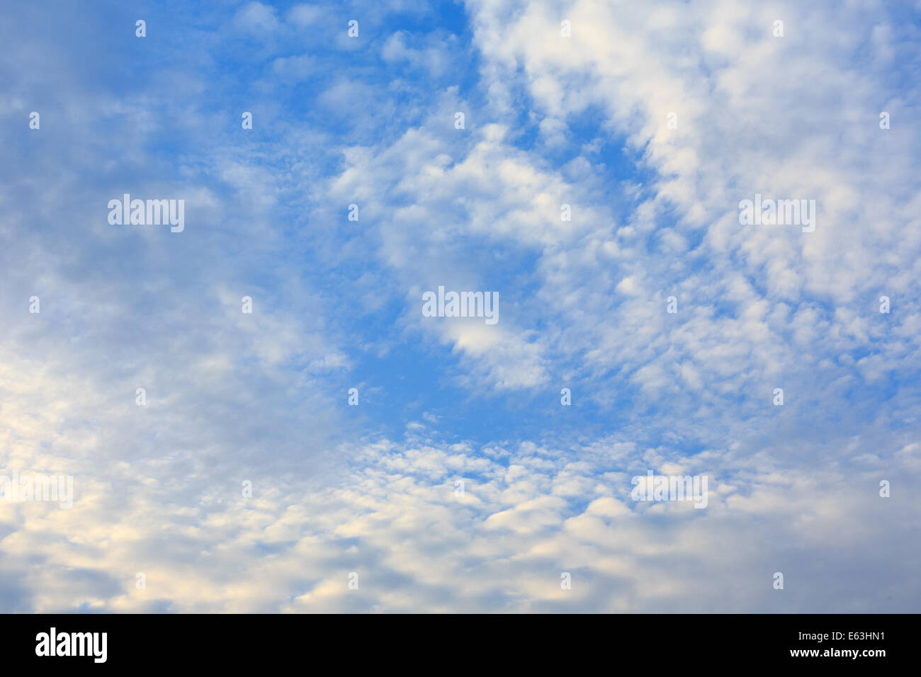 Autumn sky with fluffy clouds background - Stock Image