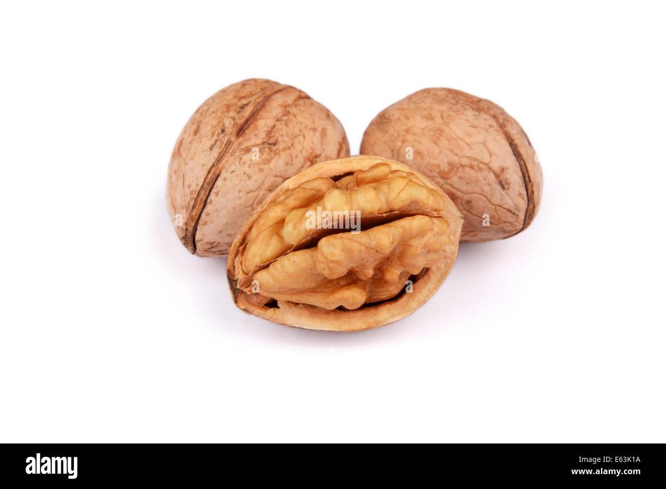 Cracked and not cracked Walnut group isolated on white background - Stock Image