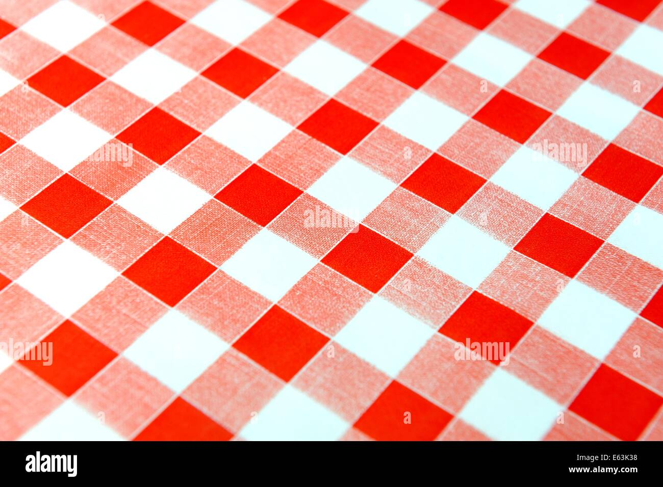 A red gingham tablecloth background - Stock Image