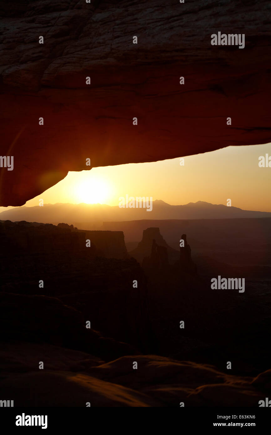 Sunrise over La Sal Mountains and under Mesa Arch, Canyonlands National Park, Utah, USA - Stock Image