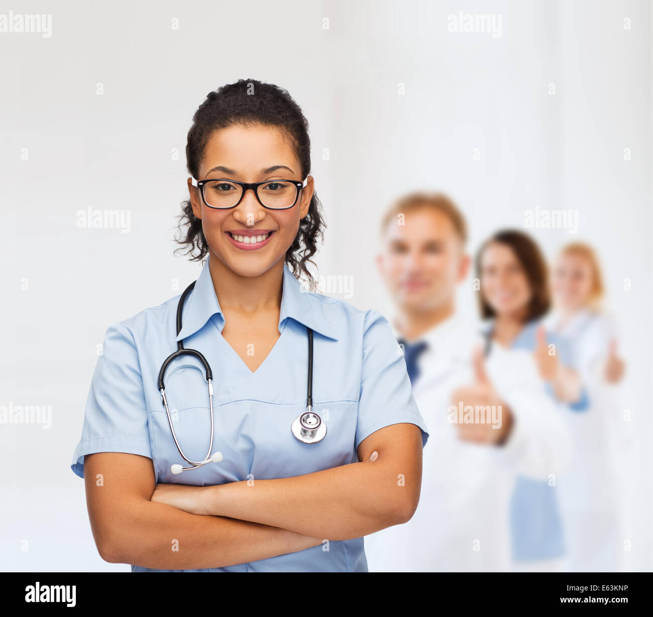 smiling female african american doctor or nurse - Stock Image