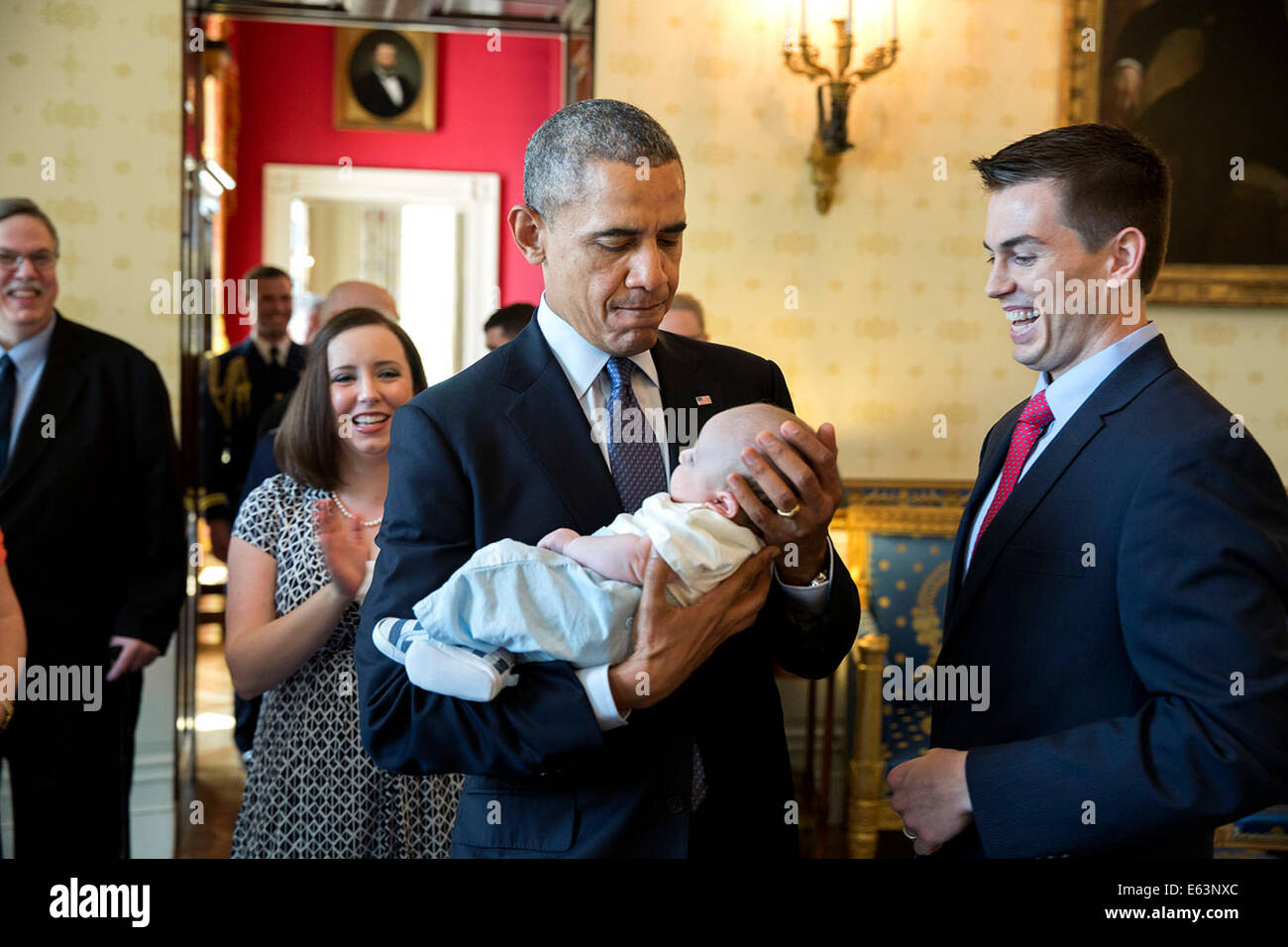 President Barack Obama hold Silas McComb, son of  Sean McComb, National Teacher of the Year, and Sarah McComb, in - Stock Image
