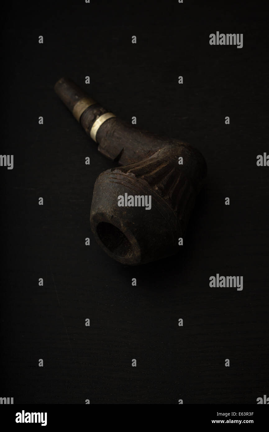 A smokers old wooden pipe. - Stock Image