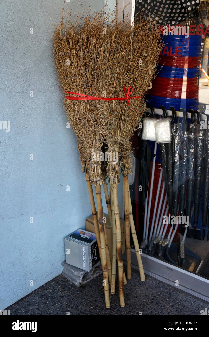 Handmade twig brooms outside a store in Japantown, Vancouver, BC, Canada - Stock Image