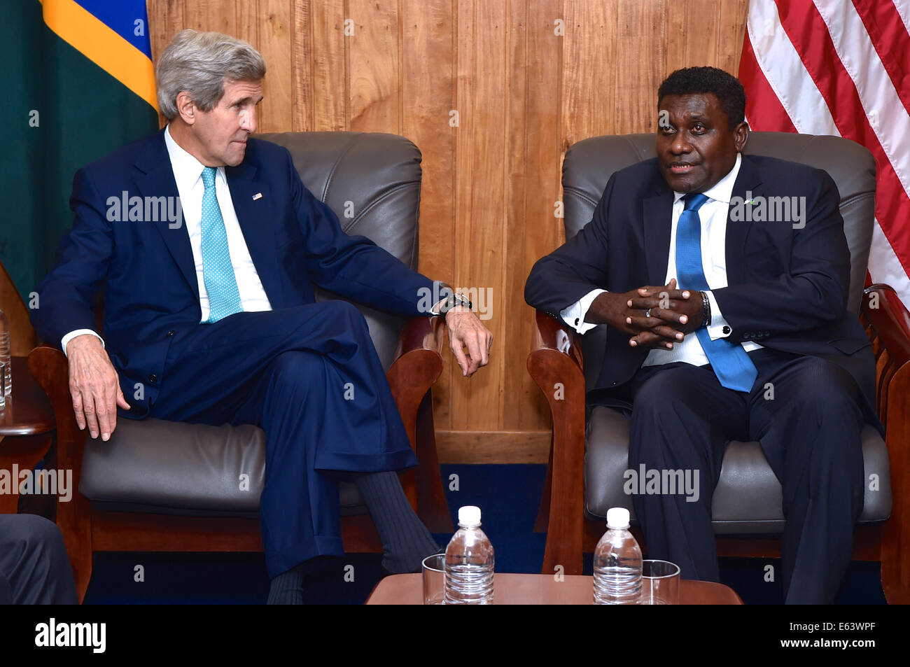 US Secretary of State John Kerry meets with Solomon Islands Prime Minister Gordon Lilo during his visit August 13, - Stock Image