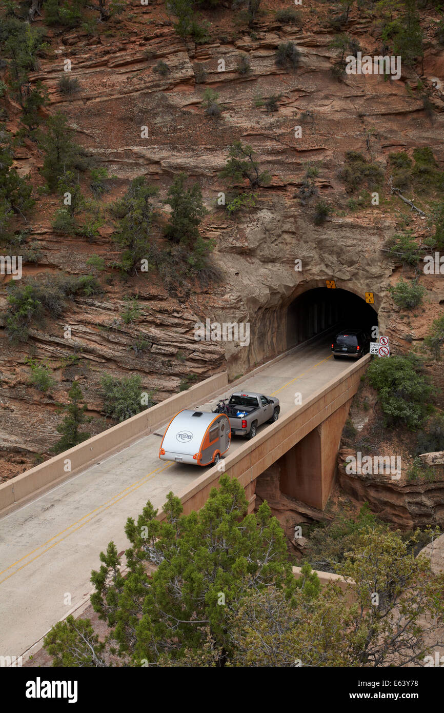 Caravan entering east portal of Zion Tunnel, Zion – Mount Carmel Highway, Zion National Park, Utah, USA - Stock Image