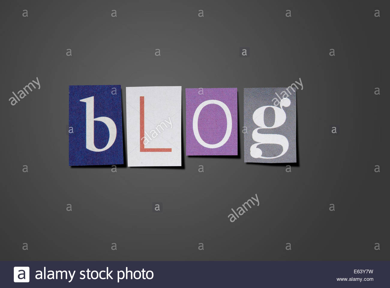Blog title made from cut out letters from printed matter. With clipping path. - Stock Image