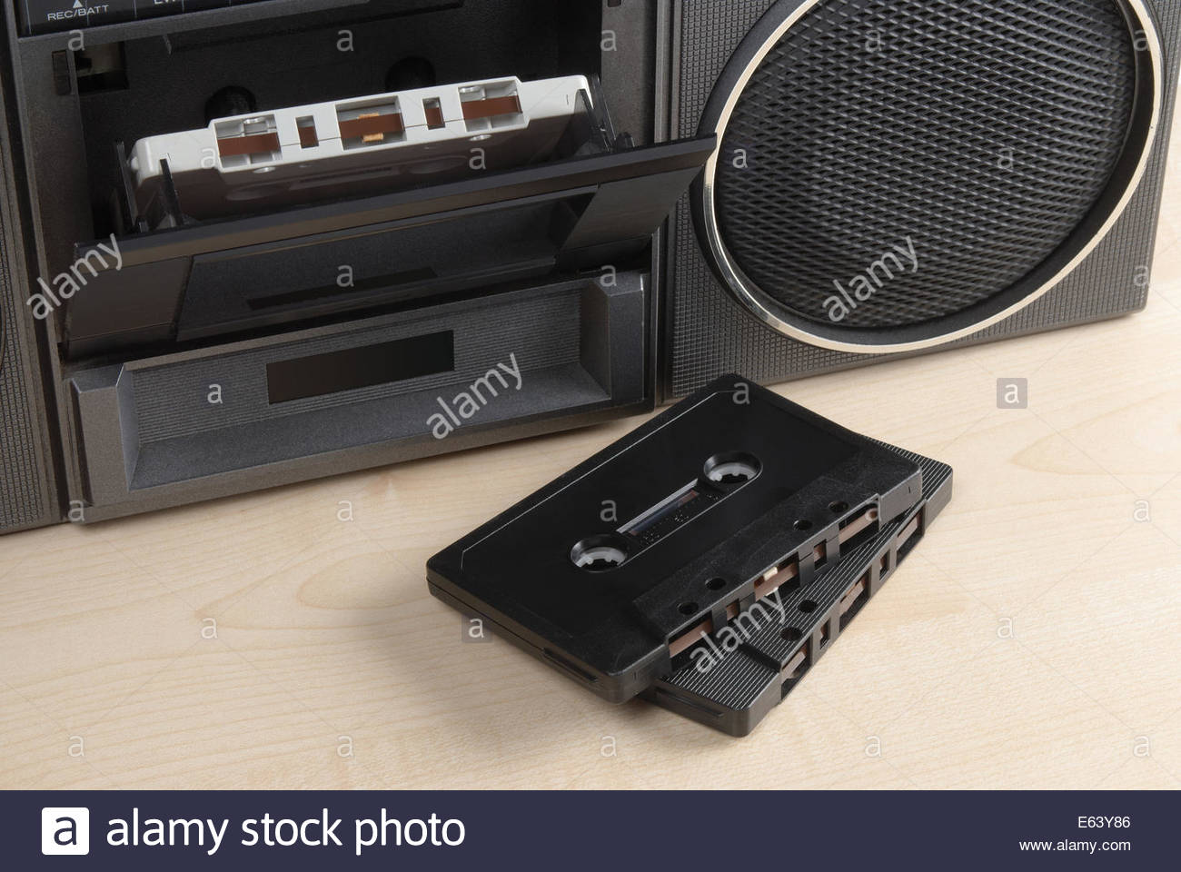 Closeup of an old radio cassette player with two cassettes in front - Stock Image