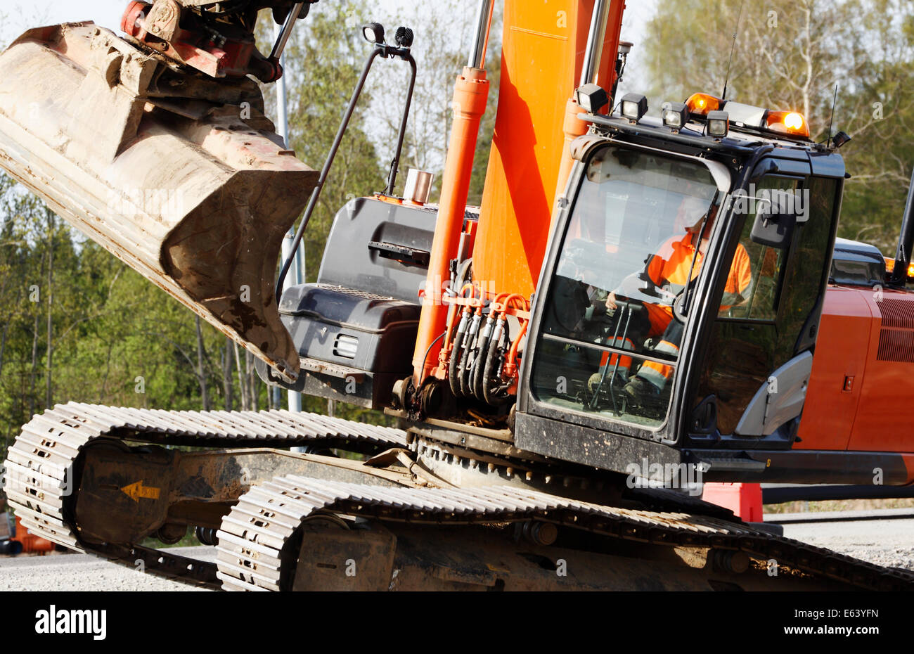 bulldozer, digger in action, excavating in a close-up concept - Stock Image