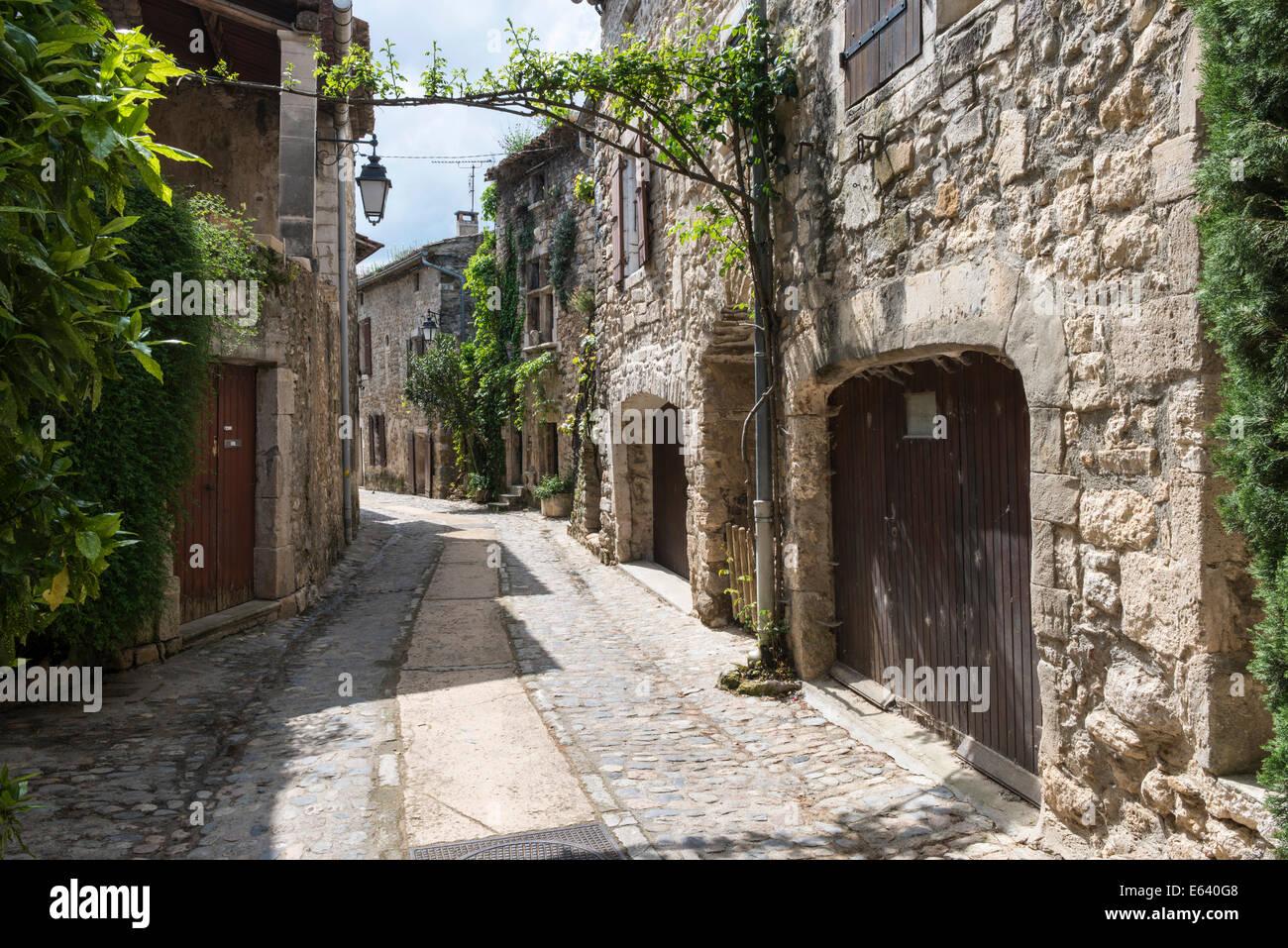 Alleyway in the village of Aiguèze, Les Plus Beaux Villages de France, Aiguèze, Languedoc-Roussillon, - Stock Image